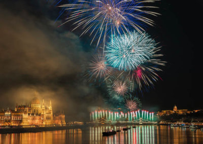 Fireworks above a river