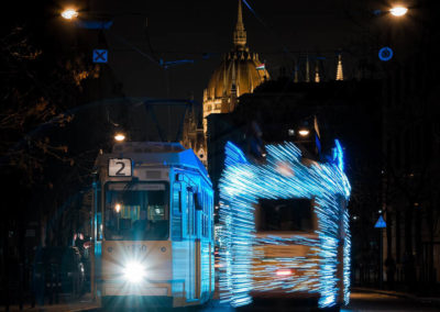 Long exposure photography of two trams with lights on